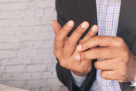 man suffering pain in hand close up