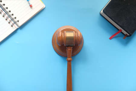 Top view of gavel on color background with copy space