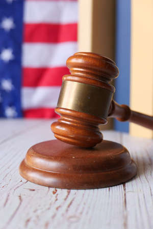 Closeup of gavel and book against american flag Stock fotó