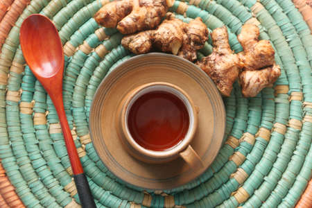 Top view of ginger tea on wooden background. Stock fotó
