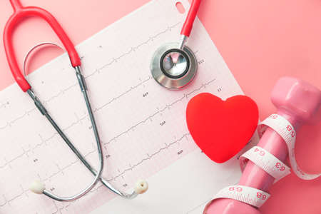 stethoscope and heart on a cardio diagram.
