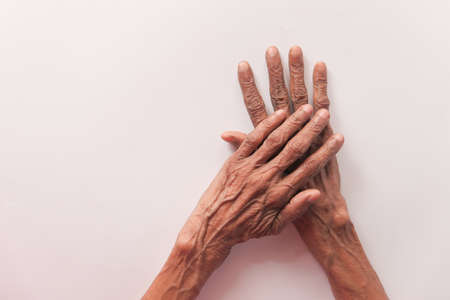 senior women touching her hand on white background Stock fotó