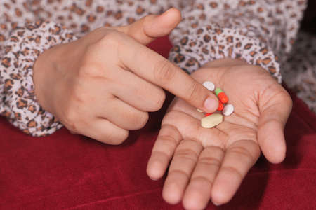 Close up of women hand taking pills Stock fotó