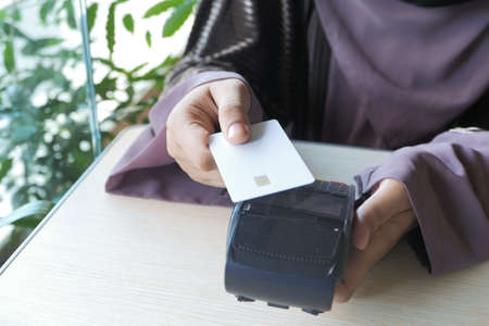 contactless payment charging from a card