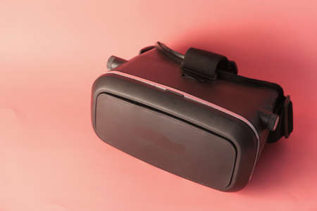 lose up of virtual reality headset, vr box on pink background Stock fotó