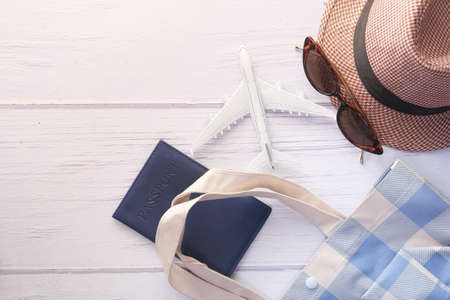 Travel accessories with hat, eyeglass and passport on table