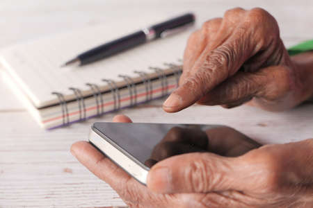 senior women hand using smart phone close up 스톡 콘텐츠