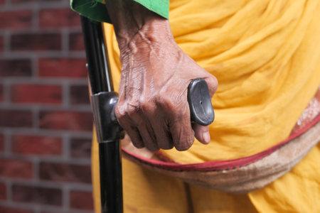 senior asian women with broken leg on crutches. 스톡 콘텐츠