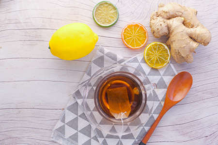 Top view of ginger tea on wooden background. 스톡 콘텐츠