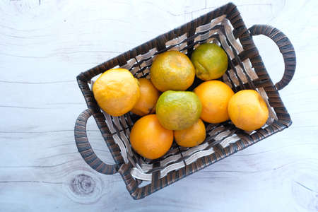 top view of many orange fruit in a bowl 스톡 콘텐츠