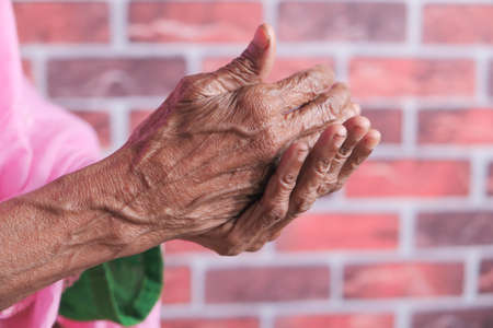 close up of senior women hand using sanitizer gel for preventing virus 스톡 콘텐츠