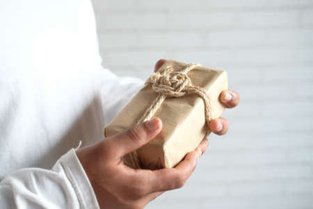 man hand holding gift box with copy space 스톡 콘텐츠