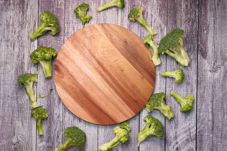 slice of brocoli and chopping board on table