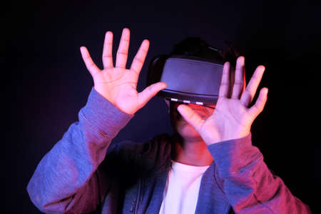 young man wearing virtual reality headset, vr box.