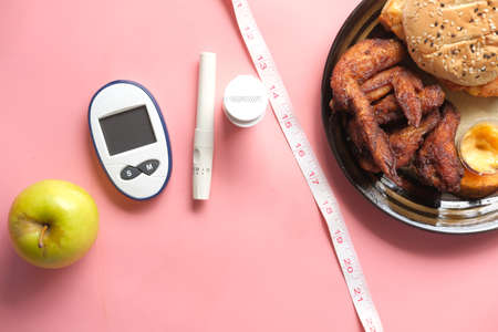 diabetic measurement tools and apple comparing with junk food