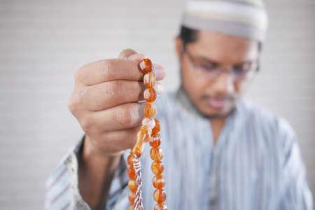 muslim man keep hand in praying gestures during ramadan, Close up