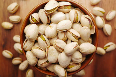 detail shot of pistachios nut on in bowl