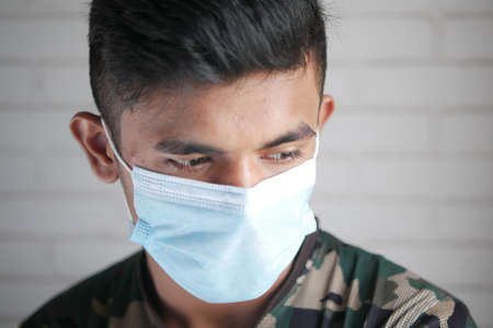 Close up of man with protective face mask looking at camera