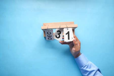 wooden calendar set on the 31 of December. Фото со стока