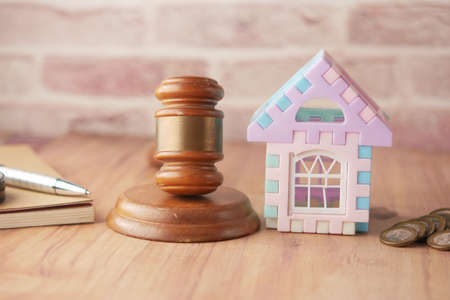 gavel , house and book with copy space on table