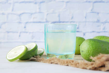 Refreshing lemon water drink on table , top view Фото со стока