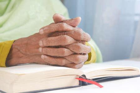 senior women hand on a bibel