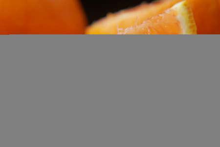 close up of slice of orange fruit on color background Фото со стока
