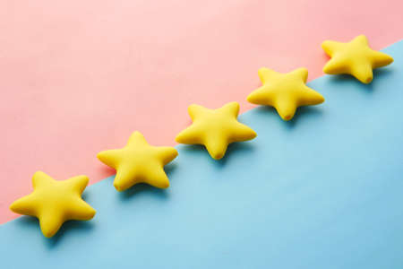 Customer review concept. Rating golden stars on blue background