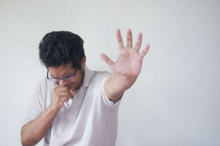 young sick man coughing and sneezes Standard-Bild
