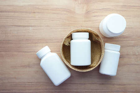 many medical pills container on table