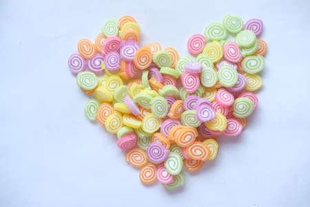 sweet jelly in heart shape on white background Фото со стока