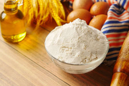 wheat flour in a bowl on table