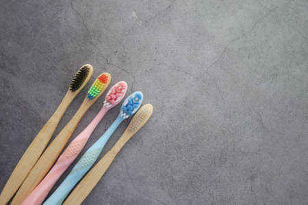colorful toothbrushes on a black background with copy space Standard-Bild