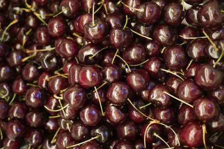 close up of cherry fruit display for sale at local store Standard-Bild