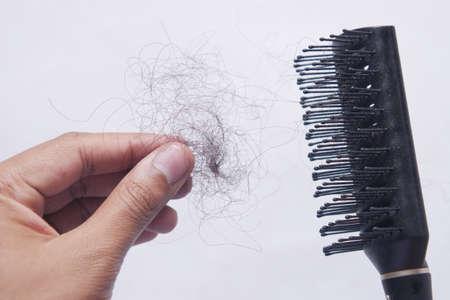man hold his list hair close up Standard-Bild