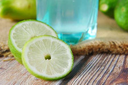 Refreshing lemon water drink on table , top view Standard-Bild