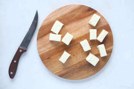 top view of cube shape fresh cheese on white background. Standard-Bild