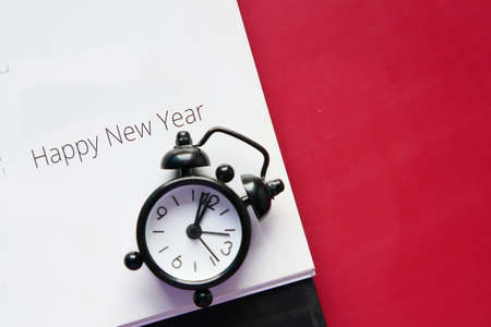 happy new year text on calendar with clock on table Standard-Bild