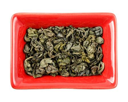 sencha: green tea in a bowl. Isolated white background