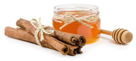 孤立した白い背景、ロープのシナモン蜂蜜ポット 写真素材