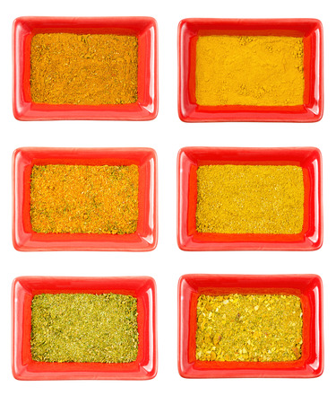 set of yellow and orange kindes seasoning, aromatic and tasty, isolated on white background