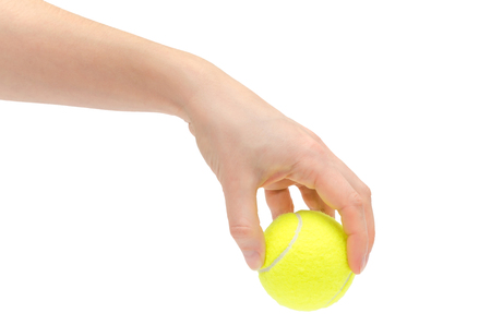 hand of young girl holding tennis ball. Isolated on white background