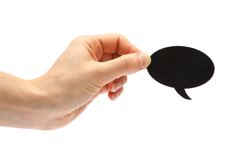 afford: hand of young girl holding speech bubble. Isolated on white background Stock Photo