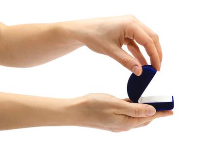fiance: female hand holding box for ring. Isolated on white background