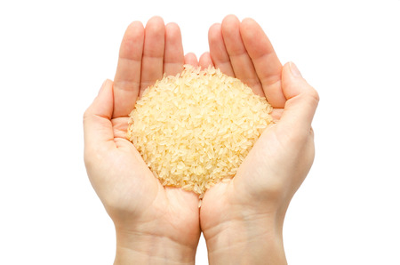 korea food: woman hand holding organic rice. Isolated on white background