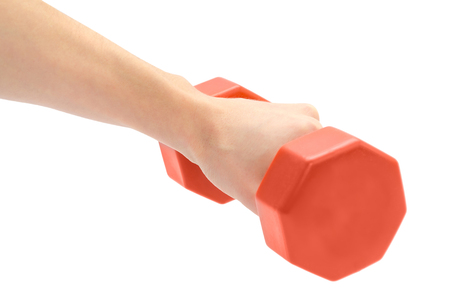 female hand takes or gives dumbbell. Isolated on white background Stock Photo