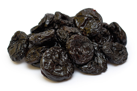 Dry and healthy prunes. isolated on white background