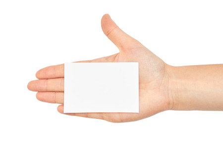businesscard: Female hands hold a business card. Isolated on white background.