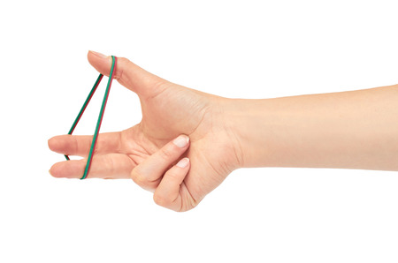 Female hands hold a rubber band. Isolated on white background.