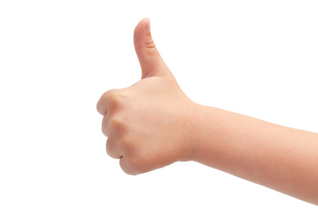 white backing: hand of kids hand gesture of thumbs up. Isolated on white background. Stock Photo